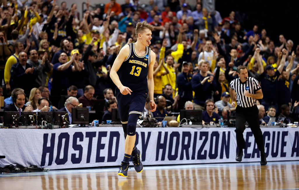 . Michigan\'s Moritz Wagner celebrates after hitting a 3-point basket during the second half of a second-round game against Louisville in the men\'s NCAA college basketball tournament Sunday, March 19, 2017, in Indianapolis. Michigan won 73-69. (AP Photo/Jeff Roberson)
