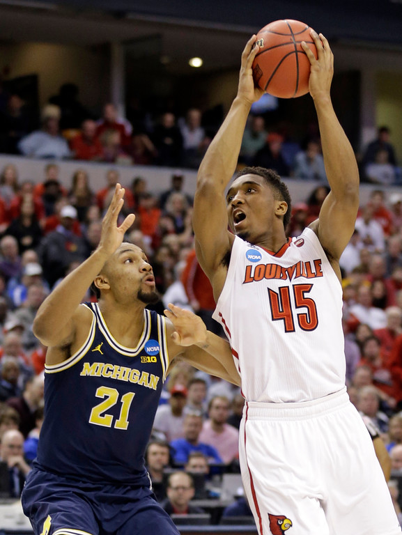 . Louisville guard Donovan Mitchell (45) shoots over Michigan guard Zak Irvin (21) during the first half of a second-round game in the men�s NCAA college basketball tournament in Indianapolis, Sunday, March 19, 2017. (AP Photo/Michael Conroy)