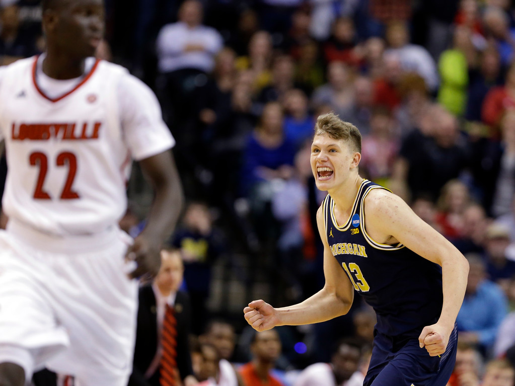 . Michigan forward Moritz Wagner (13) celebrates a 73-69 win over Louisville in a second-round game in the men�s NCAA college basketball tournament in Indianapolis, Sunday, March 19, 2017. (AP Photo/Michael Conroy)