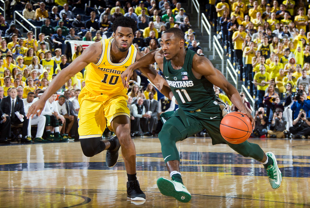 . Michigan guard Derrick Walton Jr. (10) defends Michigan State guard Lourawls Nairn Jr. (11) in the first half of an NCAA college basketball game at Crisler Center in Ann Arbor, Mich., Tuesday, Feb. 7, 2017. (AP Photo/Tony Ding)
