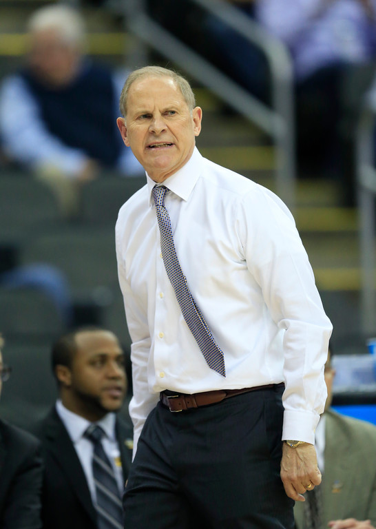 . Michigan head coach John Beilein watches from the bench during the first half of a regional semifinal against Oregon in the NCAA men\'s college basketball tournament, Thursday, March 23, 2017, in Kansas City, Mo. (AP Photo/Orlin Wagner)
