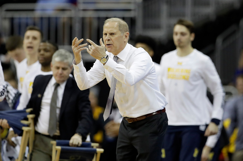 . Michigan head coach John Beilein directs his team during the first half of a regional semifinal against Oregon in the NCAA men\'s college basketball tournament, Thursday, March 23, 2017, in Kansas City, Mo. (AP Photo/Charlie Riedel)