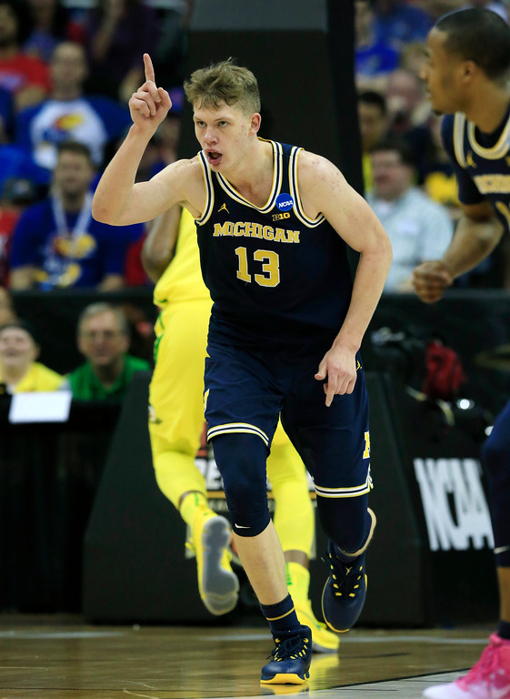 . Michigan forward Moritz Wagner celebrates after making a basket during the first half of a regional semifinal against Oregon in the NCAA men\'s college basketball tournament, Thursday, March 23, 2017, in Kansas City, Mo. (AP Photo/Orlin Wagner)