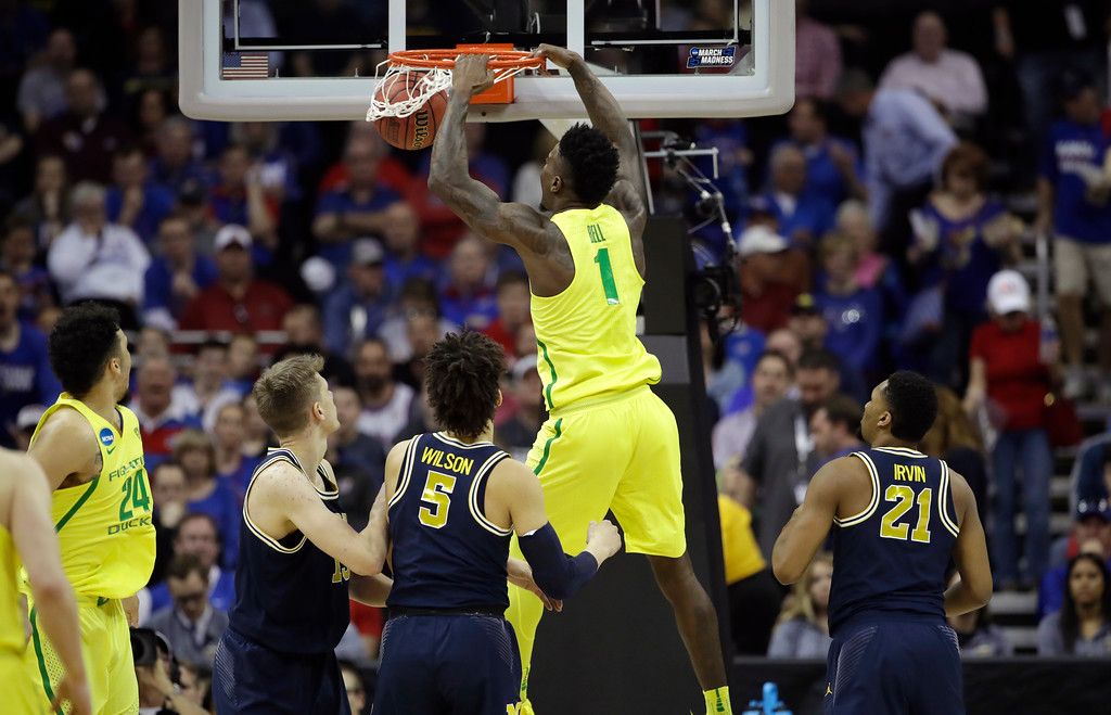 . Oregon forward Jordan Bell (1) dunks the ball during the first half of a regional semifinal against Michigan in the NCAA men\'s college basketball tournament, Thursday, March 23, 2017, in Kansas City, Mo. (AP Photo/Charlie Riedel)