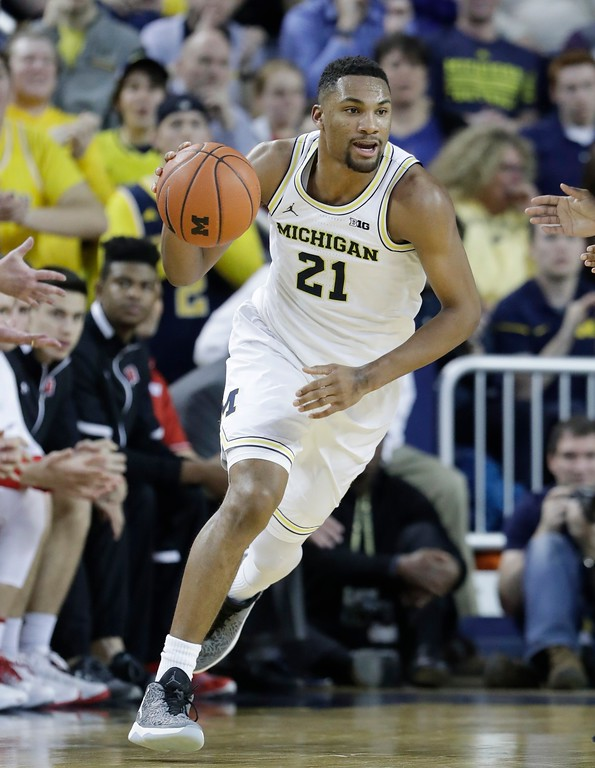 . Michigan guard Zak Irvin dribbles during the second half of an NCAA college basketball game against Wisconsin, Thursday, Feb. 16, 2017, in Ann Arbor, Mich. (AP Photo/Carlos Osorio)