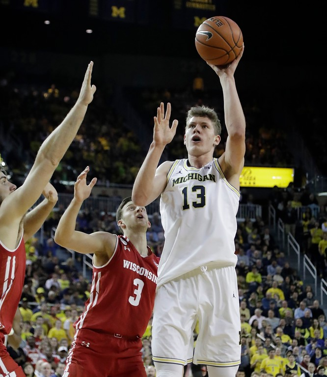 . Michigan forward Moritz Wagner (13) shoots during the second half of an NCAA college basketball game against Wisconsin, Thursday, Feb. 16, 2017, in Ann Arbor, Mich. (AP Photo/Carlos Osorio)