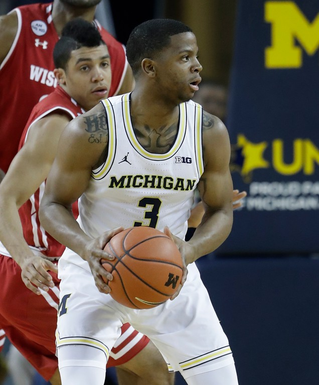 . Michigan guard Xavier Simpson looks to pass during the first half of an NCAA college basketball game against Wisconsin, Thursday, Feb. 16, 2017, in Ann Arbor, Mich. (AP Photo/Carlos Osorio)