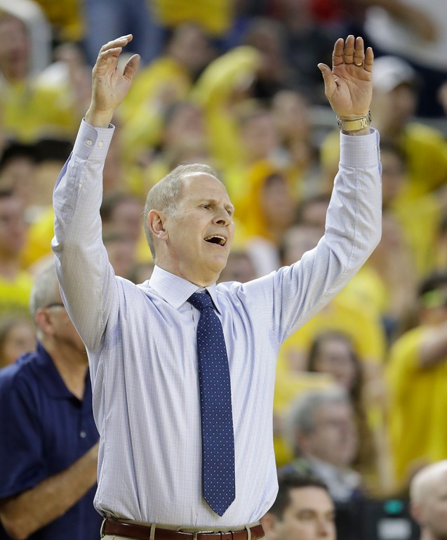 . Michigan coach John Beilein reacts after a call during the second half of the team\'s NCAA college basketball game against Wisconsin, Thursday, Feb. 16, 2017, in Ann Arbor, Mich. (AP Photo/Carlos Osorio)