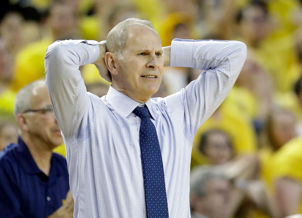 . Michigan head coach John Beilein reacts after a call during the second half of an NCAA college basketball game against Wisconsin, Thursday, Feb. 16, 2017, in Ann Arbor, Mich. (AP Photo/Carlos Osorio)