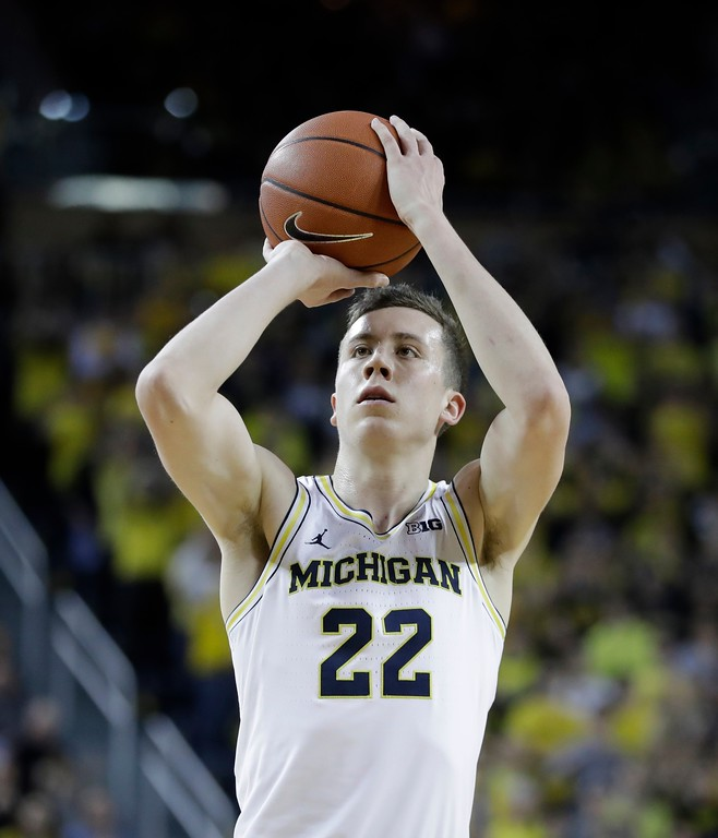 . Michigan guard Duncan Robinson shoots a free throw during the second half of an NCAA college basketball game against Wisconsin, Thursday, Feb. 16, 2017, in Ann Arbor, Mich. (AP Photo/Carlos Osorio)