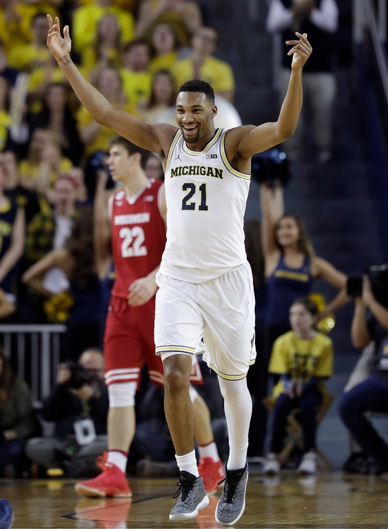 . Michigan guard Zak Irvin reacts after a 3-point basket during the first half of the team\'s NCAA college basketball game against Wisconsin, Thursday, Feb. 16, 2017, in Ann Arbor, Mich. (AP Photo/Carlos Osorio)