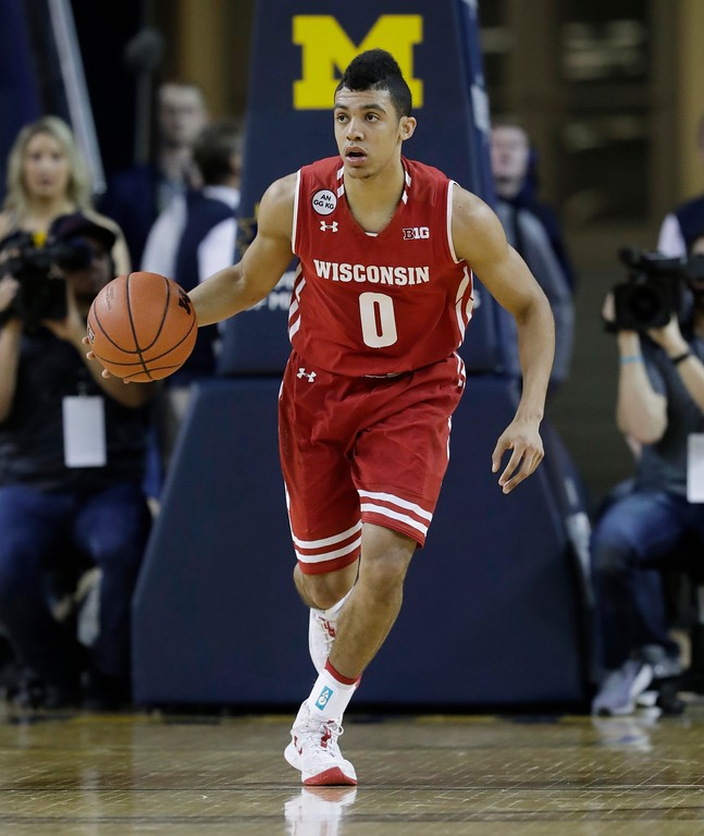 . Wisconsin guard D\'Mitrik Trice brings the ball up court during the first half of an NCAA college basketball game against Michigan, Thursday, Feb. 16, 2017, in Ann Arbor, Mich. (AP Photo/Carlos Osorio)