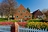 Dutch architecture with spring tulip flowers on Windmill Island, Holland, Michigan, USA.