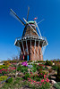 A windmill with spring tulip flowers on Windmill Island in Holland, Michigan, USA.