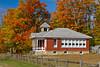 The historic Standard School, at Five Mile Creek along Highway 119 with fall foliage color near Harbor Springs, Michigan, USA.