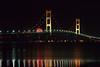 The Mackinac Bridge illuminated at night over the Straits of Mackinac joining the Upper and Lower Penninsula of Michigan, USA.