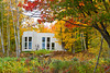 A large home in the forest with fall foliage color in Marquette, Michigan, USA.