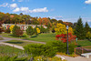 A lakeside park and The Harbor Ridge Townhouses with fall foliage color in Marquette, Michigan, USA.