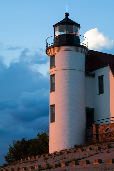 Orange sunset light shines on the Point Betsie Lighthouse. Frankfort, MI<br /> <br /> MI-090625-0071