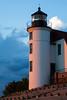 Orange sunset light shines on the Point Betsie Lighthouse. Frankfort, MI<br /> <br /> MI-090625-0071