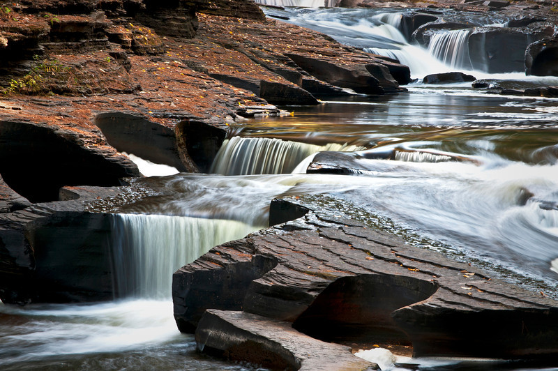 M 122                               The Presque Isle River winds through the Porcupine Mountains Wilderness State Park in Michigan's Upper Peninsula.