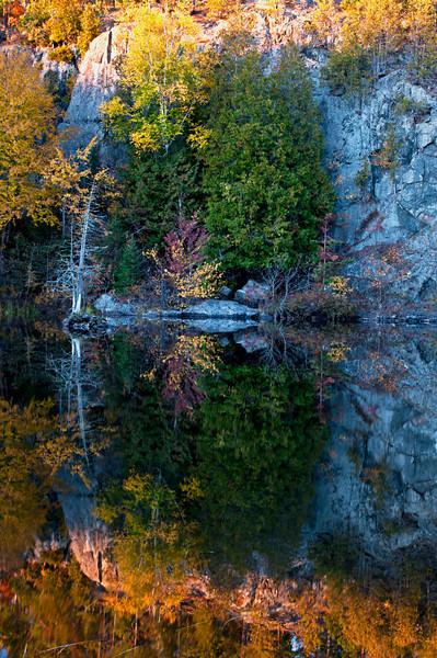 MI 166<br /> <br /> Shoreline reflections along the Michigamme River, Upper Peninsula, Michigan.