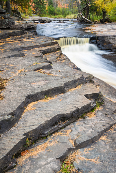 MI 220<br /> <br /> Nonsuch shale forms the riverbed of the Sturgeon River as it flows through Canyon Falls Roadside Park in Baraga County of Michigan's Upper Peninsula.