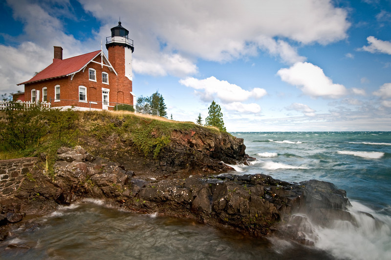 MI 053                        Gale force winds on Lake Superior produce crashing waves at Michigan's Eagle Harbor Lighthouse.