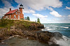MI 053                        Gale force winds on Lake Superior produce crashing waves at Michigan's Eagle Harbor Lighthouse.