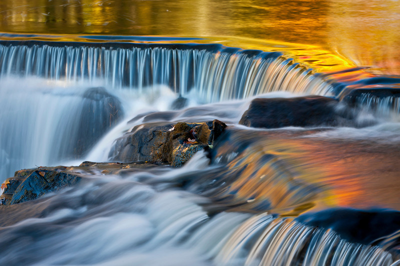 MI 098                           Fall color reflected in the surface of the Ontanogan River as it tumbles over Upper Bond Falls in Michigan's Upper Peninsula.