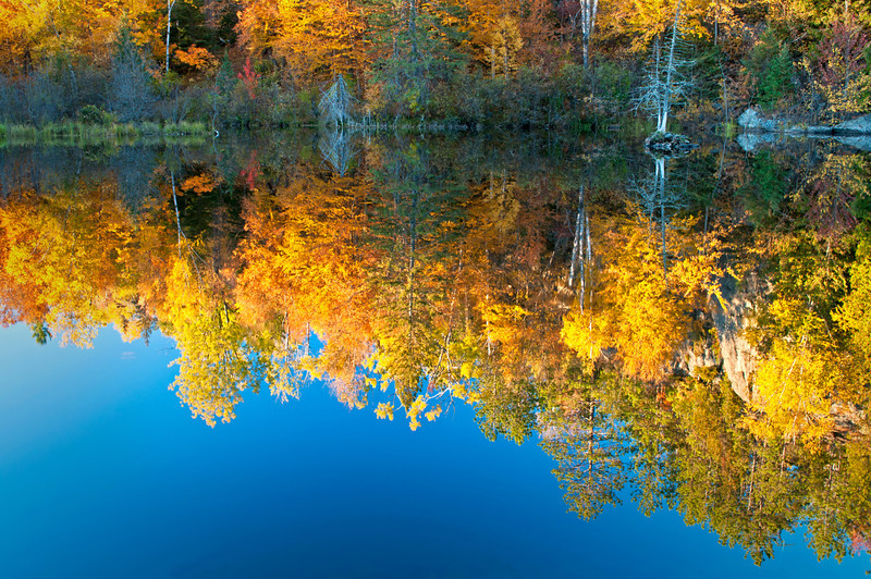 MI 161                        Autumn colors illuminated by the light of a setting sun are reflected in the calm surface of the Michigamme River near Crystal Falls in Michigan's Upper Peninsula.