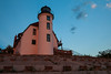 The usually white face of the Point Betsie Lighthouse glows orange at sunset. Frankfort, MI<br /> <br /> MI-090625-0074