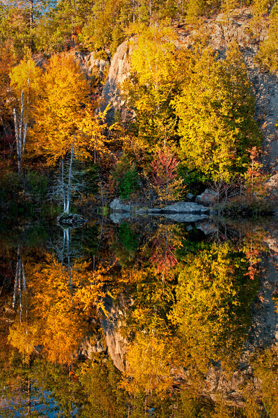 MI 160                        Autumn colors illuminated by the light of a setting sun are reflected in the calm surface of the Michigamme River near Crystal Falls in Michigan's Upper Peninsula.