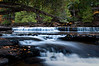 M 145<br /> <br /> The Presque Isle River tumbles over ledges of nonesuch shale that makes up the riverbed of this wilderness river in the Upper Peninsula of Michigan.