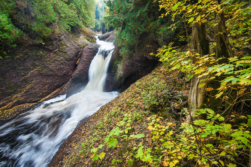 MI 225<br /> <br /> The Black River flows over Gorge Falls, just one of a series of waterfalls along the Black River Scenic Byway in Gogebic County, Michigan.