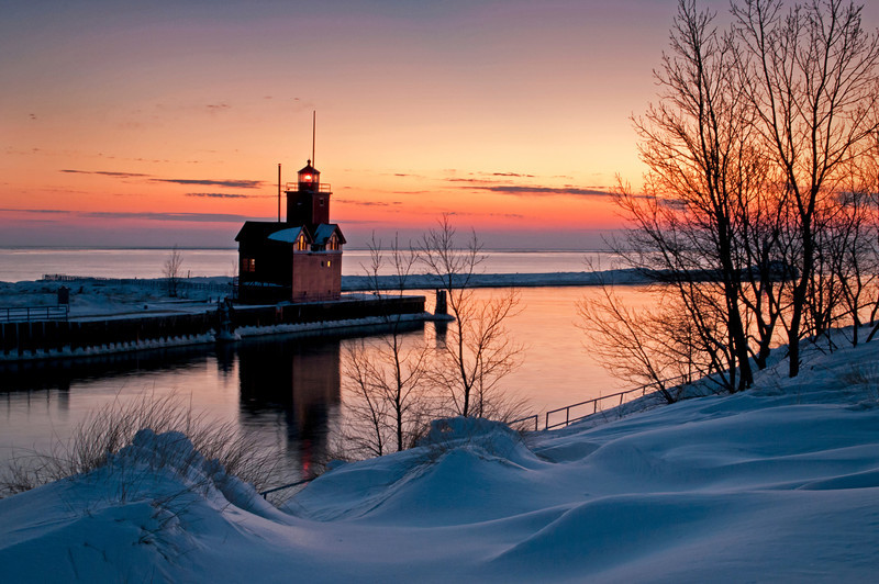 MI 214<br /> <br /> The Holland Harbor South Pierhead Lighthouse, also known as Big Red, stands guard on the icy shore of Lake Michigan at twilight.