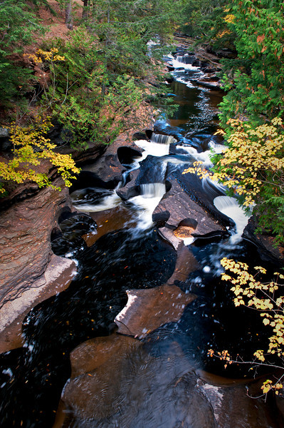 """M 140                           An area of the Presque Isle River know as """"The Bowls"""" as seen from a suspension bridge overhead."""