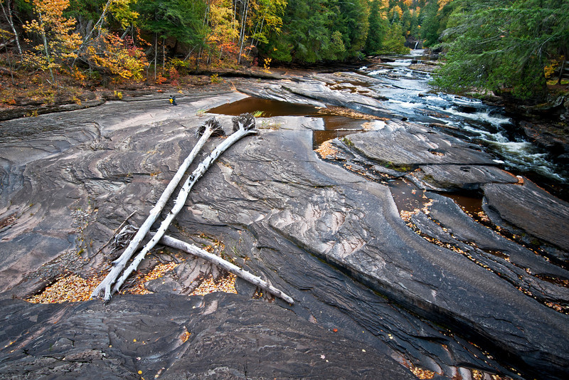 M 150<br /> <br /> Low water levels on the Presque Isle River where it flow through the Porcupine Mountains Wilderness State Park exposes the nonesuch shale riverbed.
