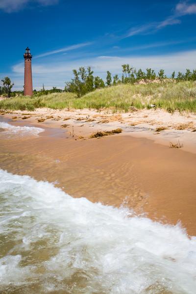 Waves break on the beach near the Little Sable Lighthouse. Mears, MI<br /> <br /> MI-150713-0153