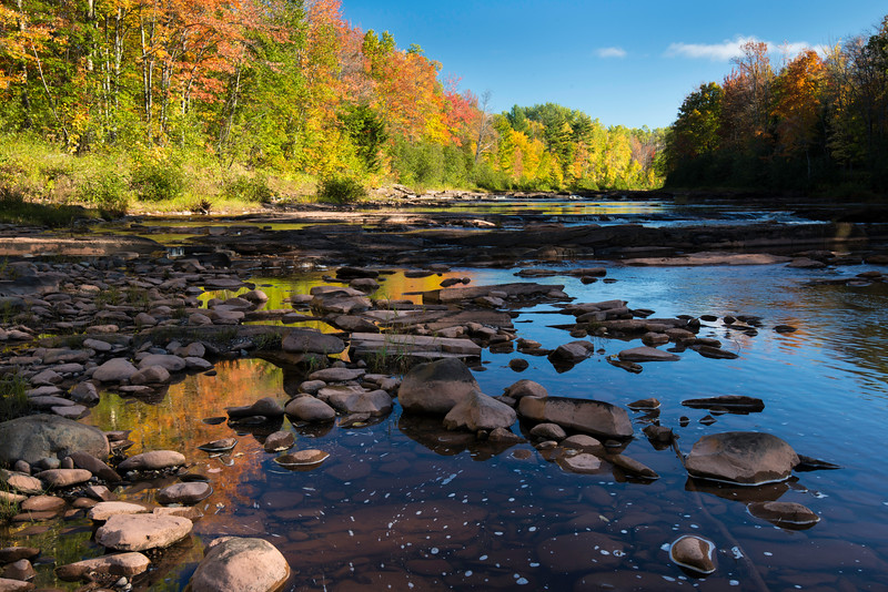 MI 219 Autumn colors in Michigan's Upper Peninsula reflect in the flowing waters of Big Iron River.  Ontonagon County, Michigan.