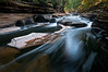 M 124                           The Presque Isle River winds through the Porcupine Mountains Wilderness State Park in Michigan's Upper Peninsula.