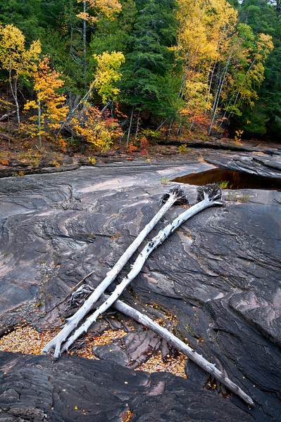 M 151<br /> <br /> Low water levels on the Presque Isle River where it flow through the Porcupine Mountains Wilderness State Park exposes the nonesuch shale riverbed.