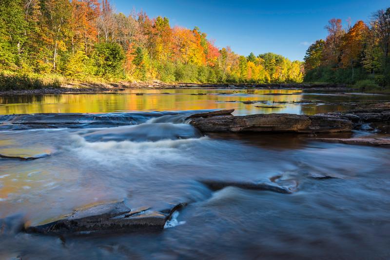 MI 218 Autumn colors in Michigan's Upper Peninsula reflect in the flowing waters of Big Iron River.  Ontonagon County, Michigan.