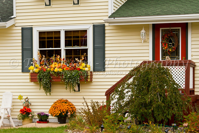 A home with autumn decor in Munising, Michigan, USA.