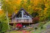A hillside chalet with fall foliage color in Munising, Michigan, USA.