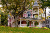 A Colonial home with fall foliage color in Petoskey, Michigan, USA.