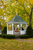 A gazeebo with fall foliage color in a small park in downtown Petoskey, Michigan, USA.