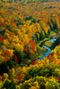 The Porcupine Mountains State Park and the Ontonagon River with fall foliage color from the Lake of the Clouds overlook near Ontonagon, Michigan, USA.