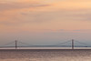 A fog bank sits behind the Mackinac Bridge during sunset. Straits of Mackinac, MI<br /> <br /> MI-090624-0083