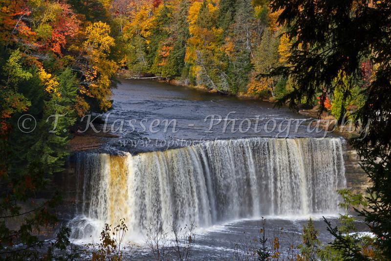 The Upper Tahquamenon Falls with fall foliage color near Newberry, Michigan, USA.